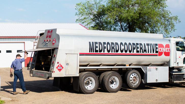 Coop worker by fuel truck